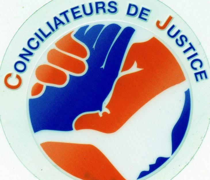 Conciliateur de justice.